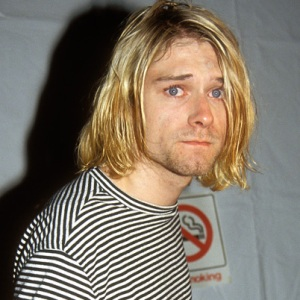 Someone's just told Kurt the wife's on the phone.